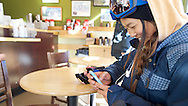 Chloe Kim finishes off her training and checks in on social media while waiting for her waffle from the Belgian Bean in Copper Mountain, CO. ©Brett Wilhelm/ESPN
