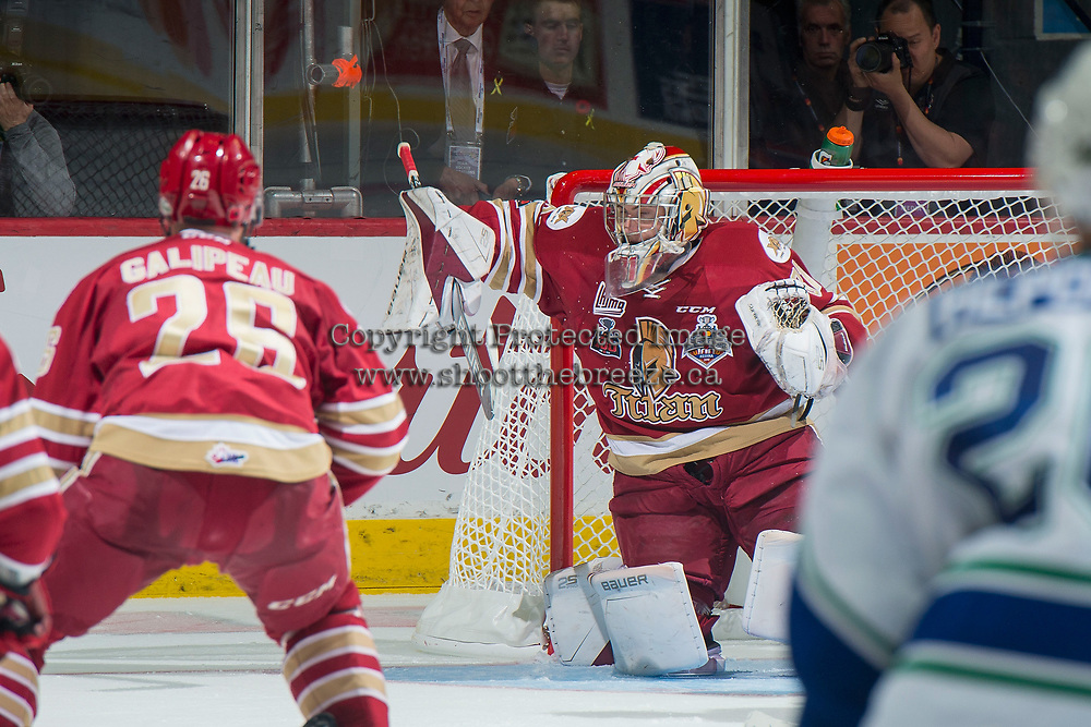 REGINA, SK - MAY 19: Evan Fitzpatrick #31 of Acadie-Bathurst Titan deflects a shot against the Swift Current Broncos at the Brandt Centre on May 19, 2018 in Regina, Canada. (Photo by Marissa Baecker/CHL Images)
