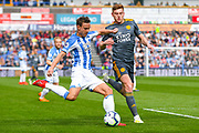 Chris Lowe of Huddersfield Town (15) and Harvey Barnes of Leicester City (19) in action during the Premier League match between Huddersfield Town and Leicester City at the John Smiths Stadium, Huddersfield, England on 6 April 2019.