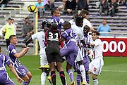 Bafetimbi Gomis jumps for the ball amongst a sea of Toulouse defenders and Toulouse goalkeeper Ali Ahamada punched the ball clear. Toulouse v Lyon (2-0), Ligue 1, Stade Municipal, Toulouse, France, 1st May 2011.