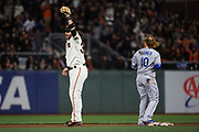 San Francisco Giants shortstop Brandon Crawford (35) reacts to tagging Los Angeles Dodgers first baseman Justin Turner (10) out to end the game at AT&T Park in San Francisco, California, on April 24, 2017. (Stan Olszewski/Special to S.F. Examiner)