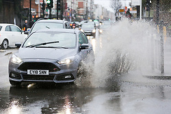 © Licensed to London News Pictures. 03/03/2019. London, UK. A car splashes water as it drives through a flood in Haringey, north London caused by heavy rainfall. Photo credit: Dinendra Haria/LNP