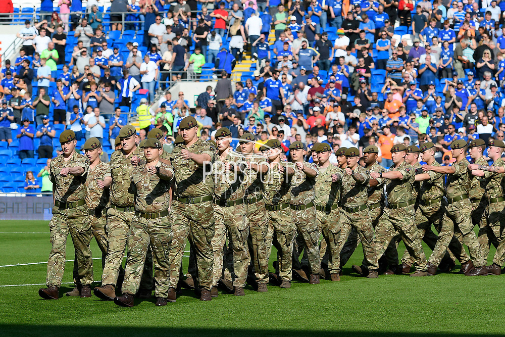 The Welsh Guards parade on the pitch before kick off during the EFL Sky Bet Championship match between Cardiff City and Middlesbrough at the Cardiff City Stadium, Cardiff, Wales on 21 September 2019.