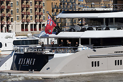 © Licensed to London News Pictures. 03/10/2016. LONDON, UK.  Staff wave as superyacht, Kismet leaves London on the River Thames passing in front of Tower Bridge during blue skies and sunny autumn weather this lunchtime, after mooring at Butlers Wharf last week. Kismet is 308 feet long and is reportedly owned by Pakistani-American billionaire Shahid Khan, who owns the National Football League (NFL) team, the Jacksonville Jaguars, who played the Colts in an International Series game at Wembley yesterday. Kismet has 6 staterooms, with the master bedroom having its own private deck with jacuzzi and helipad and can be chartered for an estimated £1m per week. Photo credit: Vickie Flores/LNP