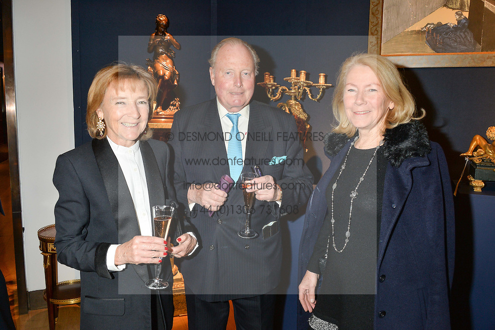 Left to right, MARTYN & AMANDA HEADLEY and ANNIE HOLCROFT at a party to celebrate the publication of Interiors For Living by Joanna Wood held at Christie's. 8 King Street, St.James's, London on 2nd March 2015.