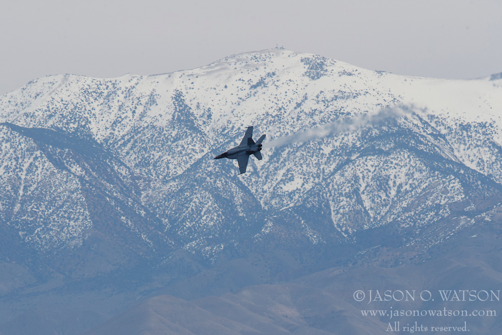 Boeing F/A-18E Super Hornet from United States Navy squadron VFA-25 Fist of the Fleet (AG 403) flies low level through the Jedi Transition, Star Wars Canyon, Death Valley National Park, California, United States of America