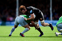Jannes Kirsten of Exeter Chiefs is tackled by Scott Baldwin of Harlequins - Mandatory by-line: Ryan Hiscott/JMP - 19/10/2019 - RUGBY - Sandy Park - Exeter, England - Exeter Chiefs v Harlequins - Gallagher Premiership Rugby