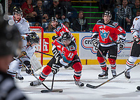 KELOWNA, CANADA - OCTOBER 4:   Tyrell Goulbourne #12 of the Kelowna Rockets fights for the puck against the Portland Winterhawks at the Kelowna Rockets on October 4, 2013 at Prospera Place in Kelowna, British Columbia, Canada (Photo by Marissa Baecker/Shoot the Breeze) *** Local Caption ***