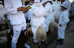 02.05.2015, Nablus, PSE, Lammopfer zum Passahfest, im Bild Angehörige die Glaubensgemeinschaft der Samaritaner beim Lammopfer zum Passahfest // Members of the ancient Samaritan community participate in the ritual of Passover Sacrifice, where sheep and goats are slaughtered, on Mount Gerizim, overlooking the West Bank town of Nablus. Samaritans descended from the ancient Israelite tribes of Menashe and Efraim but broke away from mainstream Judaism 2,800 years ago. Today, the remaining 700 Samaritans live in the Palestinian city of Nablus in the West Bank and the Israeli seaside town of Holon, south of Tel Aviv, Palestine on 2015/05/02. EXPA Pictures © 2015, PhotoCredit: EXPA/ APAimages/ Nedal Eshtayah<br /> <br /> *****ATTENTION - for AUT, GER, SUI, ITA, POL, CRO, SRB only*****