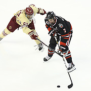 Mike McMurtry #7 of the Northeastern Huskies and Quinn Smith #27 of the Boston College Eagles during The Beanpot Championship Game at TD Garden on February 10, 2014 in Boston, Massachusetts. (Photo by Elan Kawesch)