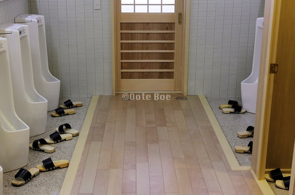 male toilet room with slippers