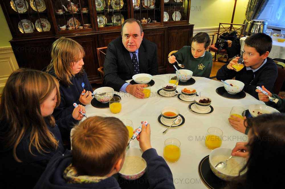 EDINBURGH, UK - 6th October 2010: Two pupils from St Mary's Primary School in Edinburgh and five pupils from Dalmally Primary School in Argyll joined First Minister Alex Salmond for porridge during breakfast at Bute House to mark world Porridge Day.  World Porridge Day is expected to raise thousands of pounds for the charity Mary's Meals and takes place this Sunday.  (Photograph: Callum Bennetts/MAVERICK)
