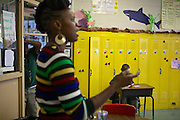 Third grader Marquet Williams, right, and other students listen to instructions from their teacher Courtney Jackson, left, at Adelaide Davis Elementary School on Nov. 26, 2012 in Washington, D.C. Last week DCPS Chancellor Kaya Henderson proposed closing 20 under-enrolled schools in the District. Davis Elementary is one of 20 schools in the DCPS system included in the school closure proposal. There are currently 178 students enrolled in Davis Elementary and the second floor of the school is only used for music classes and the library...CREDIT: Lexey Swall for The Wall Street Journal.DCSCHOOLS