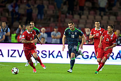 BELGRADE, SERBIA - Sunday, June 11, 2017: Wales' Sam Vokes and Serbia's Aleksandar Kolarov during the 2018 FIFA World Cup Qualifying Group D match between Wales and Serbia at the Red Star Stadium. (Pic by David Rawcliffe/Propaganda)
