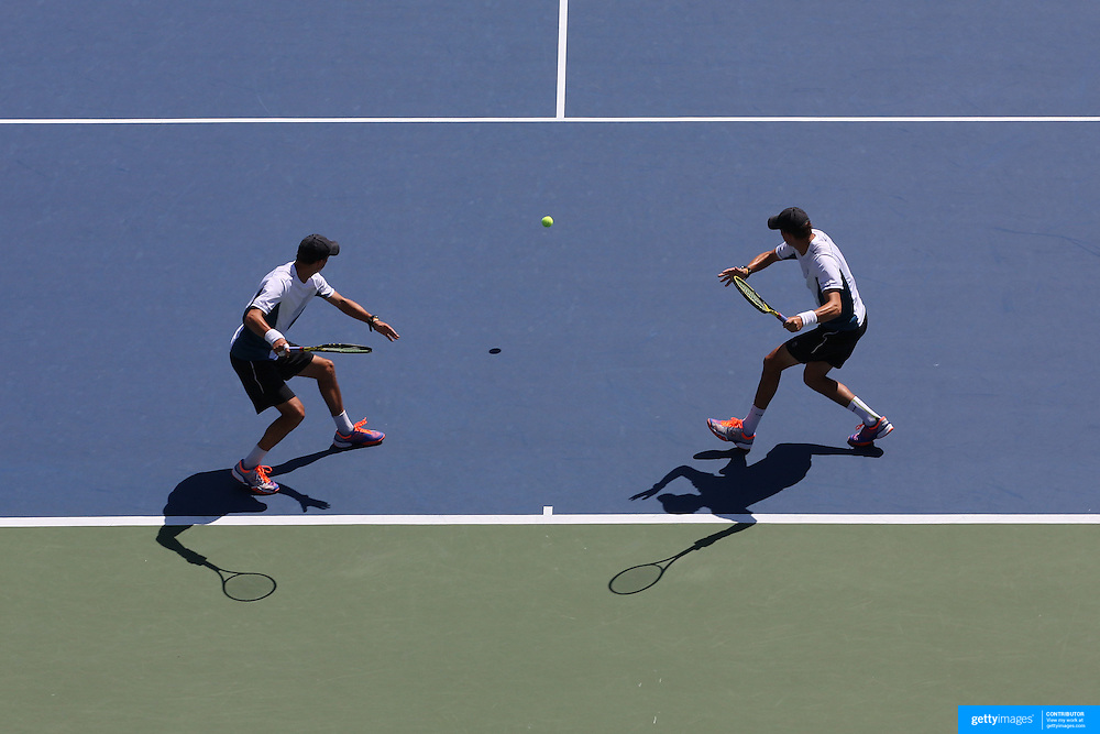 Bob Bryan and Mike Bryan, USA, in action during their Men's doubles Semifinals win over Scott Lipsky and<br /> Rajeev Ram, USA,  during the US Open Tennis Tournament, Flushing, New York, USA. 4th September 2014. Photo Tim Clayton