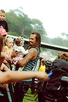 Michael Franti with fans, after closing 12th Annual Power to the Peaceful Festival in Golden Gate Park, in San Francisco, CA.  Copyright 2010 Reid McNally.