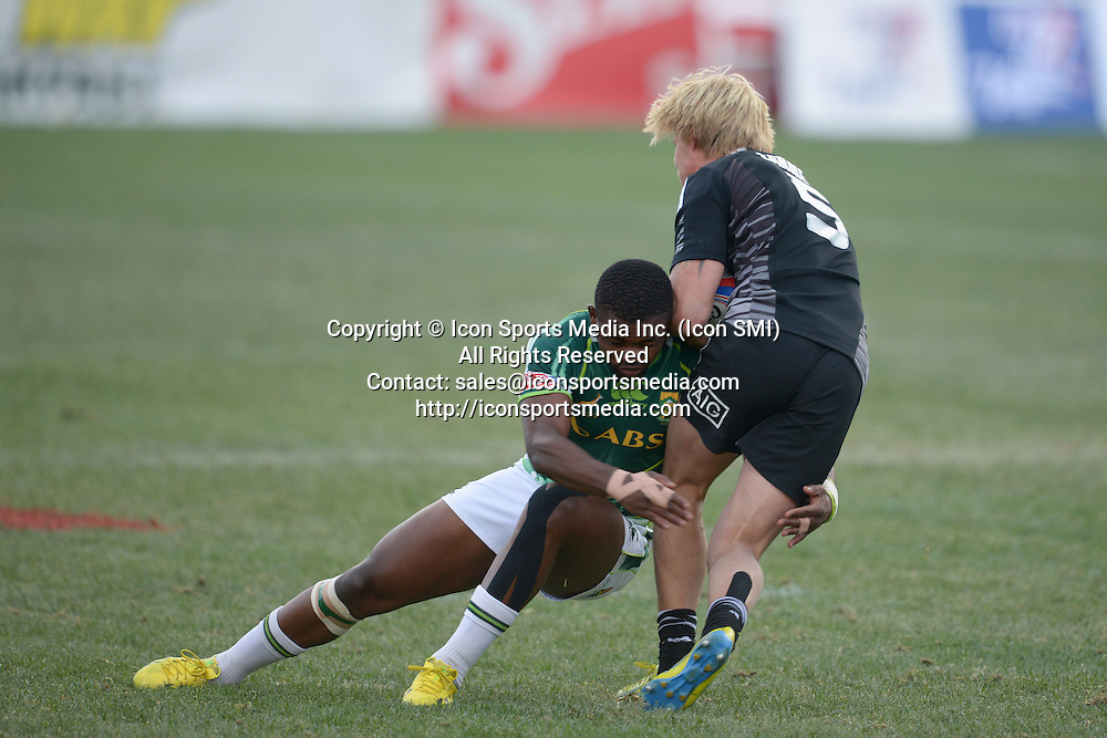10 February 2013: Warwick Lahmert (5) of New Zealand gets tackled by Tshotsho Mbovane (11) of South Africa in the Cup final of round 5 of the HSBC Sevens World Series of Rugby at Sam Boyd Stadium in Las Vegas, Nevada. South Africa defeated New Zealand 40-21.