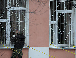 61009829<br /> Police investigate at the Moscow secondary school 263 in Moscow, Russia, Feb. 3, 2014. A gunman who had taken about 20 students hostage at a Moscow public school was detained and all hostages were rescued, the Interior Ministry said Monday. The gunman, a senior student of the Moscow secondary school 263, killed a policeman and a teacher, and injured another police officer, Moscow, Russia, Monday, 3rd February 2014. Picture by  imago / i-Images<br /> UK ONLY