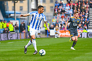 Karlan Grant of Huddersfield Town (16) in action during the Premier League match between Huddersfield Town and Leicester City at the John Smiths Stadium, Huddersfield, England on 6 April 2019.