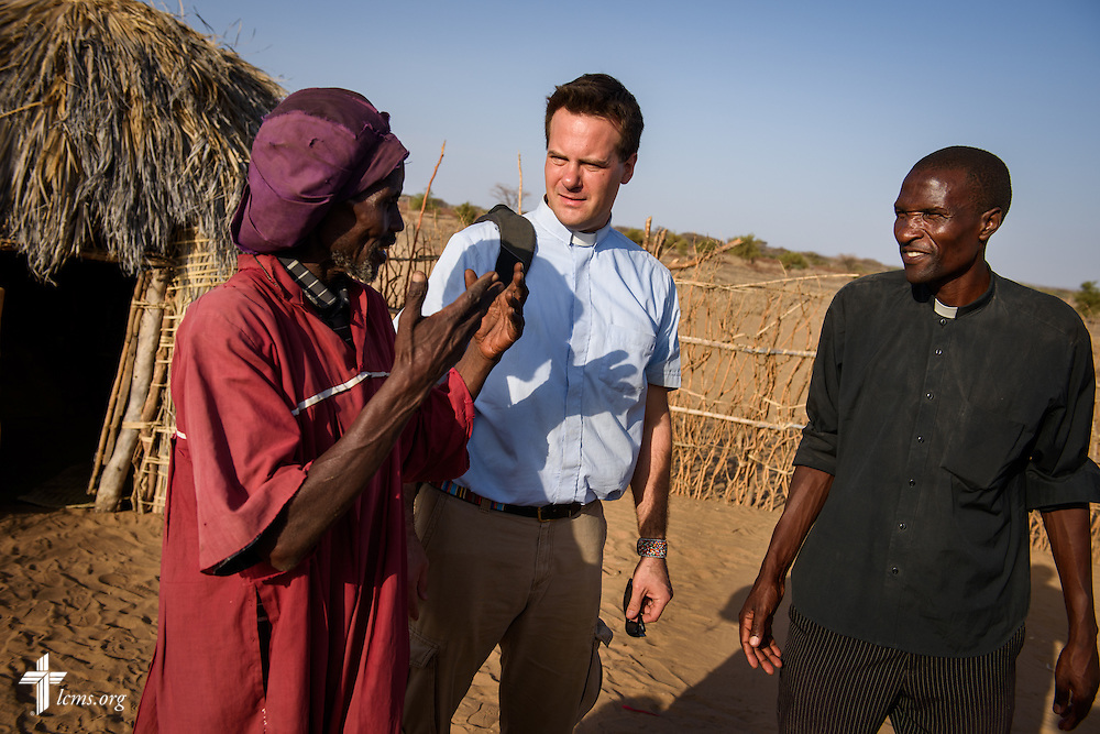 The Rev. Shauen Trump, LCMS missionary and area director for Eastern and Southern Africa, meets with a man in his small village located in the Turkana region of northwest Kenya on Friday, Oct. 16, 2015. Trump is flanked by the Rev. Daniel Mutai (left), pastor in the Evangelical Lutheran Church in Kenya (ELCK). LCMS Communications/Erik M. Lunsford