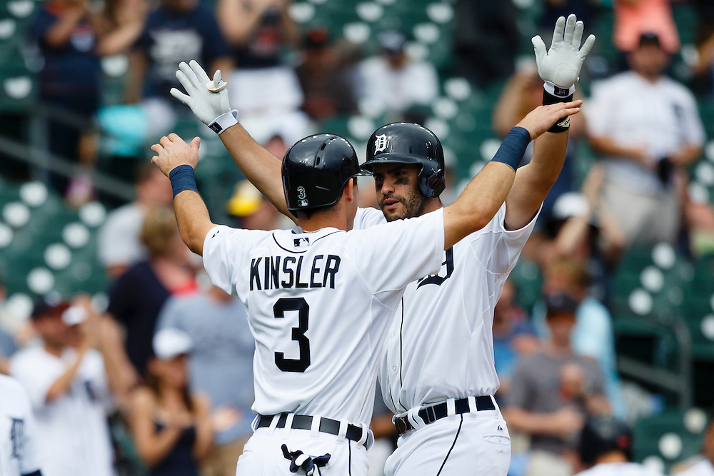 Jun 14, 2015; Detroit, MI, USA; Detroit Tigers right fielder J.D. Martinez (28) receives congratulations from second baseman Ian Kinsler (3) after he hits a three run home run in the sixth inning against the Cleveland Indians at Comerica Park. Mandatory Credit: Rick Osentoski-USA TODAY Sports