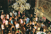 A large chandelier hanging over the people on the dancefloor, Posh at Addington Palace, UK, August, 2004
