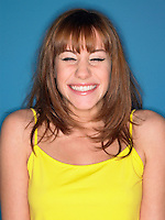 Girl in studio smiling head and shoulders