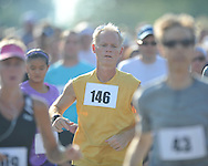Adam Gussow (146) runs at the starting line at the Stars and Stripes 5K in Oxford, Miss. on Monday, July 4, 2011.