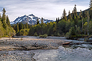 Mount Shuksan towers over the confluence of Swamp Creek and the North Fork of the Nooksack River in the Mount Baker-Snoqualmie National Forest in Washington State, USA