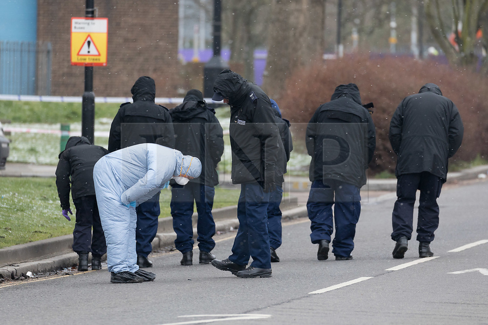 © Licensed to London News Pictures. 17/03/2018. London, UK. Police and forensic officers at the scene in South Street, Enfield, north east London where a murder investigation has been launched. Police were called shortly before 4am this morning to reports of shots fired in South Street, Enfield. One man was found with stab injuries and a suspected gunshot wound and declared dead at the scene. A second victim was found suffering from stab injuries and was taken to hospital where he remains in a serious but stable condition. Photo credit: Vickie Flores/LNP