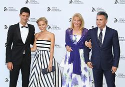 © Licensed to London News Pictures. Novak Djokovic,  Jelena Ristic, Dijana and Srdjan Djokovic at the Novak Djokovic Foundation London gala dinner, The Roundhouse, London UK, 08 July 2013. Photo credit: Richard Goldschmidt/LNP