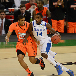 Mar 31, 2012; New Orleans, LA, USA; Kentucky Wildcats forward Michael Kidd-Gilchrist (14) dribbles as Louisville Cardinals guard/forward Wayne Blackshear (25) defends during the second half in the semifinals of the 2012 NCAA men's basketball Final Four at the Mercedes-Benz Superdome. Mandatory Credit: Derick E. Hingle-US PRESSWIRE