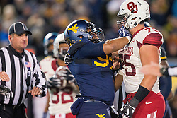 Nov 19, 2016; Morgantown, WV, USA; West Virginia Mountaineers defensive lineman Noble Nwachukwu (97) pushes Oklahoma Sooners offensive lineman Dru Samia (75) and is called for an unsportsmanlike penalty during the second quarter at Milan Puskar Stadium. Mandatory Credit: Ben Queen-USA TODAY Sports