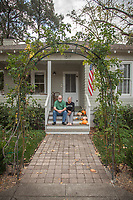 """When I bought this house in 1989, my twelve year old son explained: ' I can't believe you bought this dump!'  Now, he can't wait for me to die.""  -Retired Architect Tim Wilkes with his wife, Leslie, in front of their 115 year old home on Cedar Street in Calistoga.  timothy.wilkes@gmail.com"