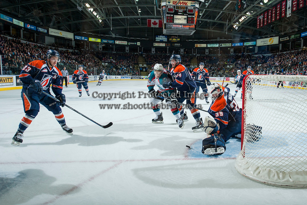 KELOWNA, CANADA - MARCH 14: Gage Quinney #20 of Kelowna Rockets is checked by Ryan Rehill #24 as Connor Ingram #39 of the Kamloops Blazers makes a save on March 14, 2015 at Prospera Place in Kelowna, British Columbia, Canada.  (Photo by Marissa Baecker/Shoot the Breeze)  *** Local Caption *** Gage Quinney; Ryan Rehill; Connor Ingram;