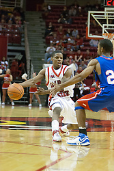 "02 December 2006: Keith ""Boo"" Richardson extends for a side arm pass.  In a non-conference game, the Mavericks of University of Texas at Arlington lost to the Redbirds home 86-61. The win was the 5th in a row for the Redbirds, the longest winning streak in 6 years. the game was played at Redbird Arena in Normal Illinois on the campus of Illinois State University.<br />"