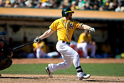OAKLAND, CA - SEPTEMBER 22: Brandon Moss #37 of the Oakland Athletics at bat against the Minnesota Twins during the fifth inning at O.co Coliseum on September 22, 2013 in Oakland, California. The Oakland Athletics defeated the Minnesota Twins 11-7 as they clinched the American League West Division. (Photo by Jason O. Watson/Getty Images) *** Local Caption *** Brandon Moss