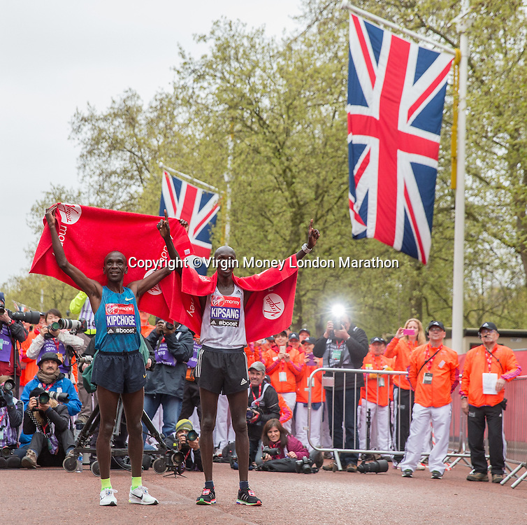 Eliud Kipchoge and Wilson Kipping of Kenya after the finish of the Elite Men's race at the Virgin Money London Marathon, Sunday 26th April 2015.<br /> <br /> Scott Heavey for Virgin Money London Marathon<br /> <br /> For more information please contact Penny Dain at pennyd@london-marathon.co.uk