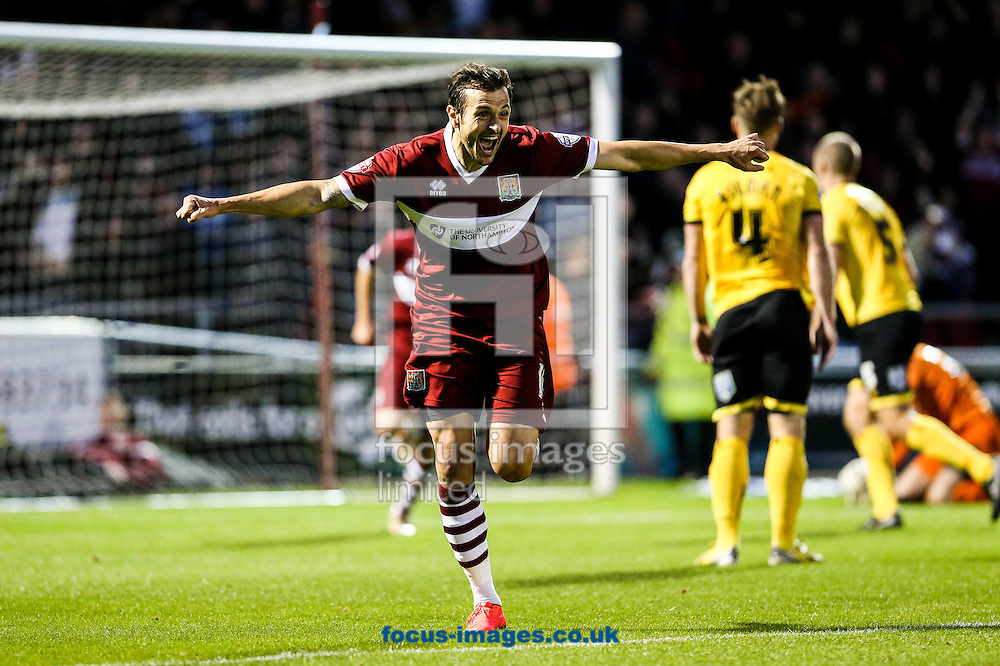 Alex Nicholls of Northampton Town (centre) celebrates scoring their second goal during the Sky Bet League 2 match at Sixfields Stadium, Northampton<br /> Picture by Andy Kearns/Focus Images Ltd 0781 864 4264<br /> 01/11/2014