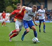 Coventry City Midfielder, Ryan Kent and Bury Defender Chris Hussey tussle for the ball just outside the area during the Sky Bet League 1 match between Bury and Coventry City at Gigg Lane, Bury, England on 26 September 2015. Photo by Mark Pollitt.