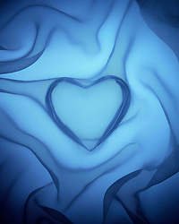 Aug. 23, 2012 - Heart covered in blue silk (Credit Image: © Image Source/ZUMAPRESS.com)