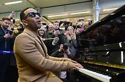 PABEST US singer John Legend plays the Elton John piano at St Pancras Station, London.