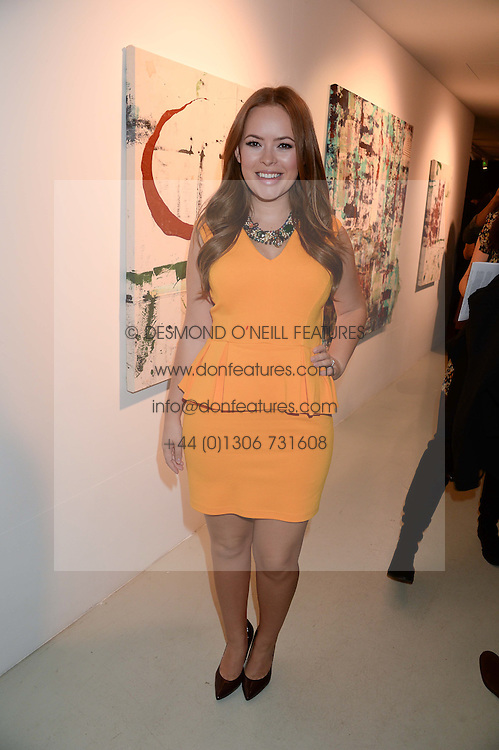 TANYA BURR at a private view of an exhibition of paintings by Billy Zane entitled 'Save The Day Bed' held at the Rook & Raven Gallery, Rathbone Place, London on 10th October 2013.
