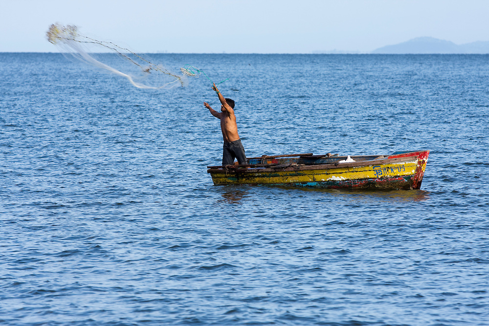 Fishing as the people here have for hundreds of years, a lone fisherman casts his net into  Lake Nicaragua on the Island of Ometepe.