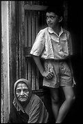 Grandmother & Grandson in doorway.<br /> Chennai.