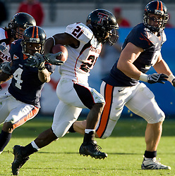 Texas Tech defensive back De'Shon Sanders (21) rushes past Virginia cornerback Vic Hall (4) before being tacked by Virginia defensive end Chris Long (91).  The Texas Tech Red Raiders defeated the Virginia Cavaliers 31-28 in the 2008 Konica Menolta Gator Bowl held at the Jacksonville Municipal Stadium in Jacksonville, FL on January 1, 2008.