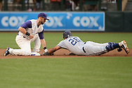PHOENIX, AZ - APRIL 27:  Yangervis Solarte #26 of the San Diego Padres safely slides under Chris Owings #16 of the Arizona Diamondbacks to steal second base in the first inning at Chase Field on April 27, 2017 in Phoenix, Arizona.  (Photo by Jennifer Stewart/Getty Images)