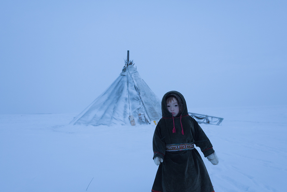 Yaqua, a young Nenets boy outside the family chum on the Yamal Peninsula in Arctic Siberia.