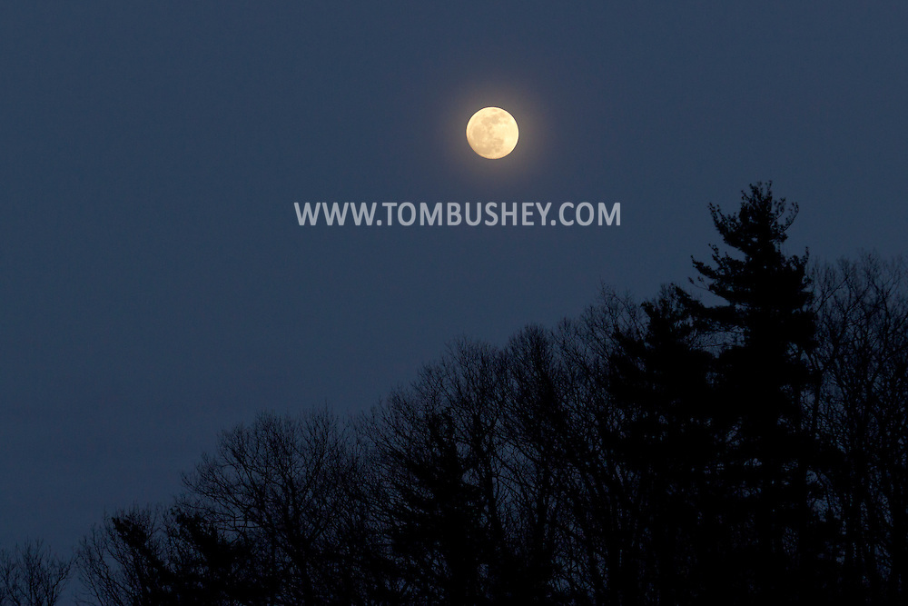 Salisbury Mills, New York - The almost-full moon rises over Schunnemunk Mountain on April 13, 2014. The full moon was the following day.