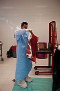 A Forensic expert catalogs the blood soaked clothing of a drug shootings at the Juarez City Forensic Lab in Juarez, Mexico January 16, 2009.  An ongoing drug war has already claimed more than 40 people since the start of the year. More than 1600 people were killed in Juarez in 2008, making Juarez the most violent city in Mexico.    (Photo by Richard Ellis)